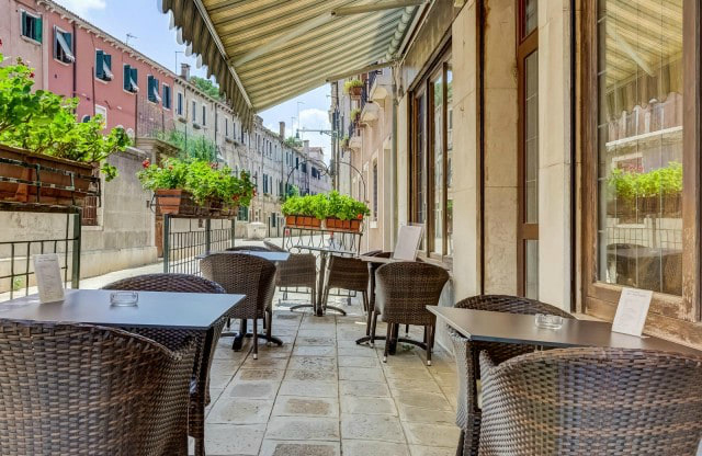 hotel patio with tables and greenery