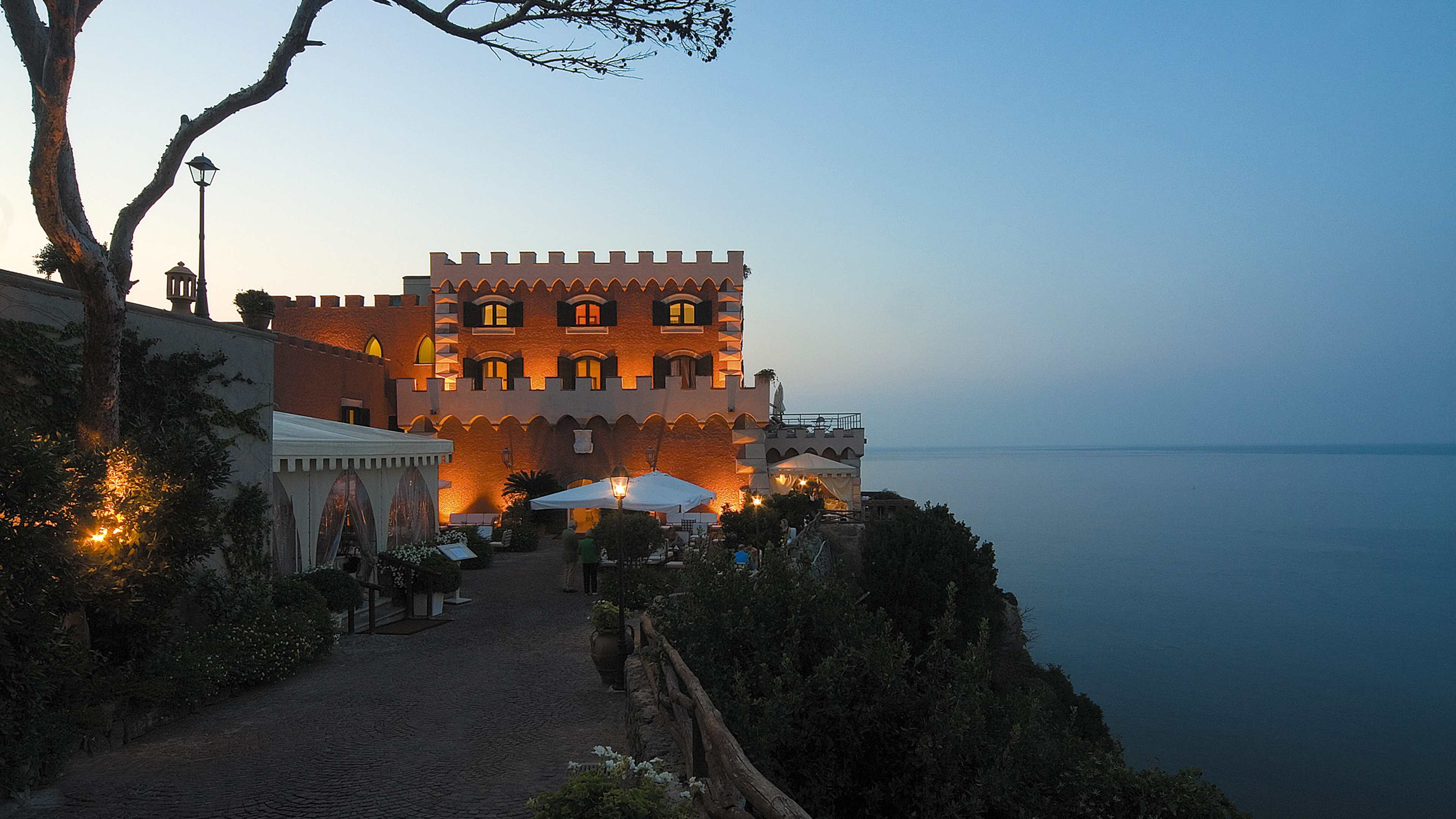 Mezzatorre Resort & Spa perched on a hill at sunset