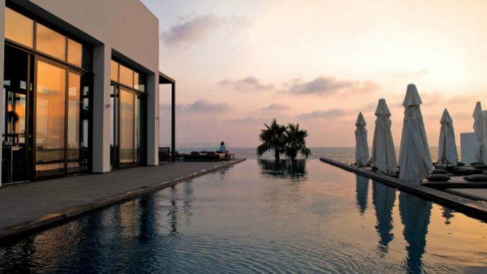 Almyra hanging pool at dusk