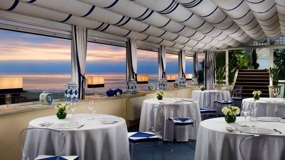 Grand Hotel Principe restaurant with sunset view over the water