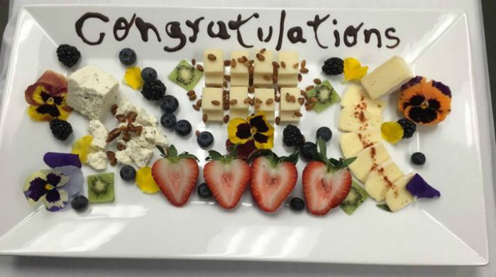 platter of welcome treats with congratulations written