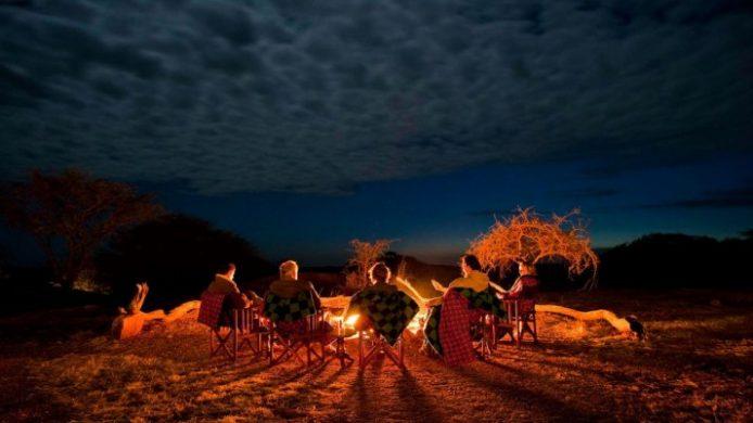 Sanctuary Kusini group around campfire