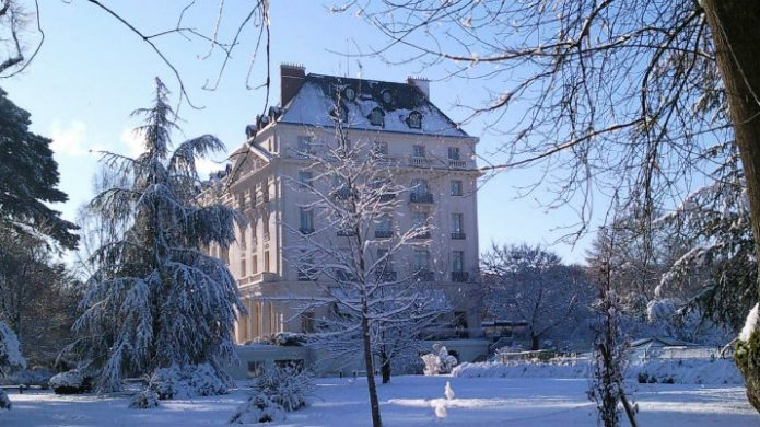 hotel surrounded by snow in winter