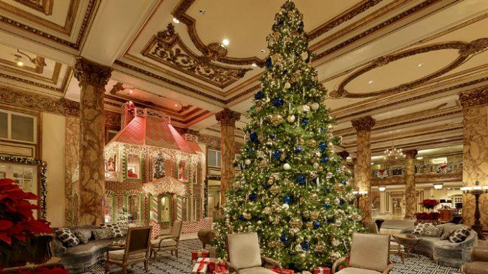 grand christmas tree in hotel lobby
