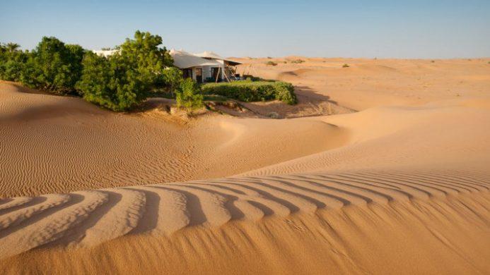 luxury glamping amidst desert sand dunes