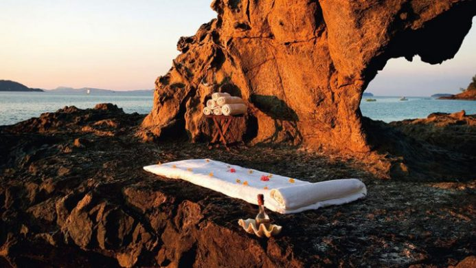 spa bed in rocks on beach