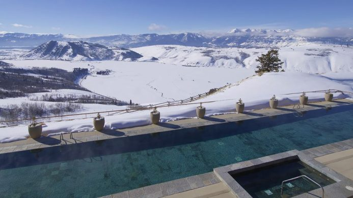 Amangani outdoor lap pool overlooking snow landscape