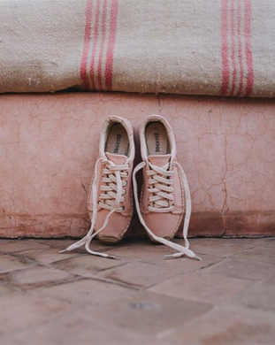 Blush pink Soludos shoes against Moroccan rugs