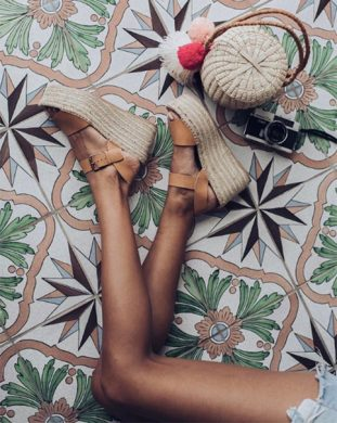 Pink and green tiles with a shot of platform sandals