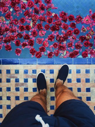 Kasbah Tamadot Pool's Edge with Flower Petals