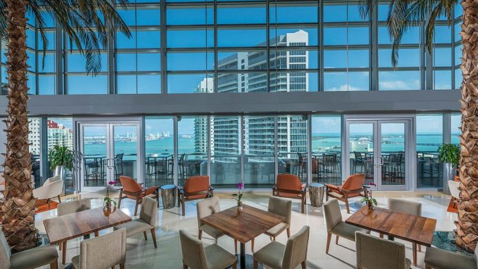 Conrad Miami lobby lounge with floor to ceiling windows and ocean view