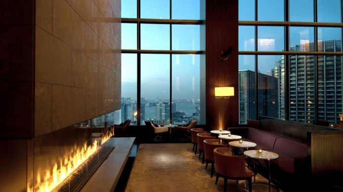 Conrad Tokyo Lobby with fireplace and large windows