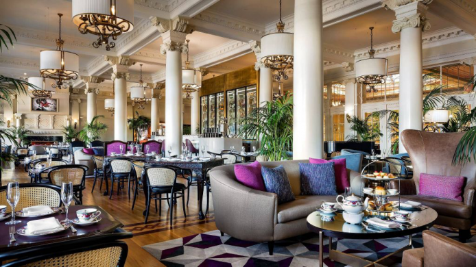 Fairmont Empress tea lounge with tables and sofas