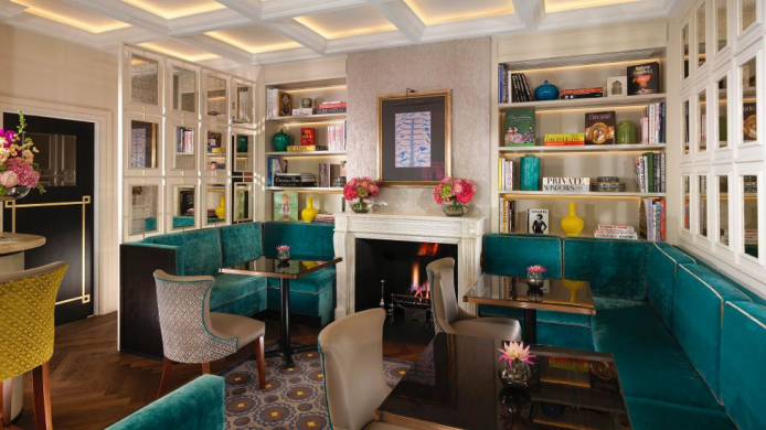 Flemings Mayfair lounge with colorful books and banquettes