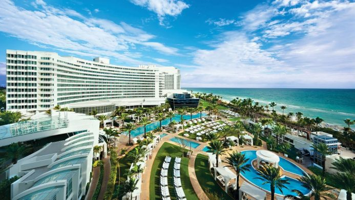 Fontainebleau Miami Beach aerial photo of poolscape, resort and ocean
