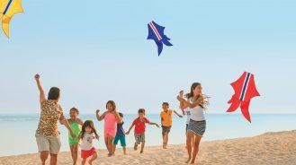 The Ritz-Carlton, Bali Kids Flying Kites on the Beach
