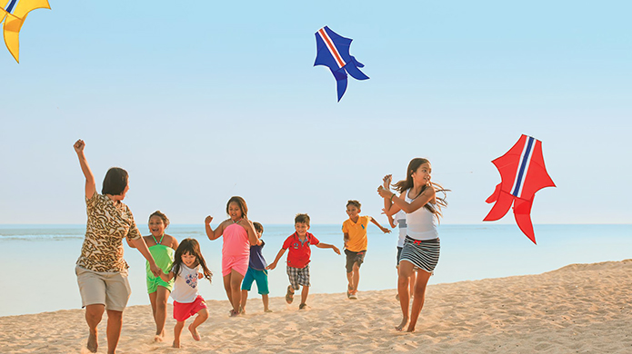 The Ritz-Carlton, Bali Kids Flying Kites on the Beach