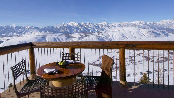 Amangani terrace overlooking snow landscape