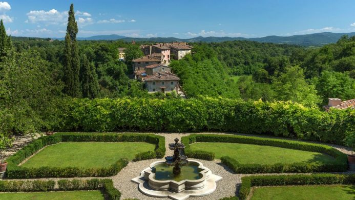 Il Borro Tuscany hotel garden surrounded by greenery and forest