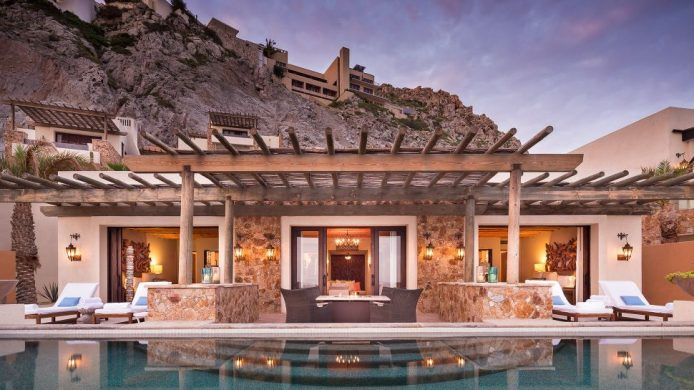 The Resort at Pedregal cliff side cabanas and pools in front of residence