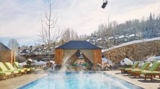Viceroy Snowmass heated outdoor pool with snow background
