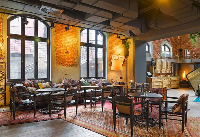25hours Hotel Altes Hafenamt NENI Restaurant with industrial windows and exposed brick walls