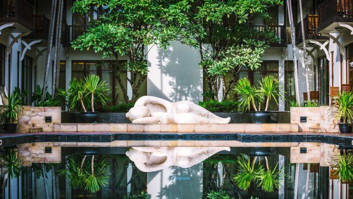 Anantara Angkor Resort pool garden with lounging statue