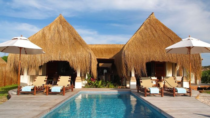 Pool in front of thatched villa at Azura resort