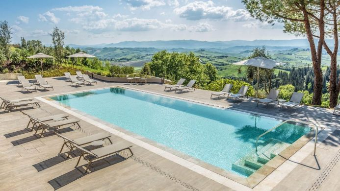 Il Castelfalfi outdoor pool patio overlooking Tuscan countryside