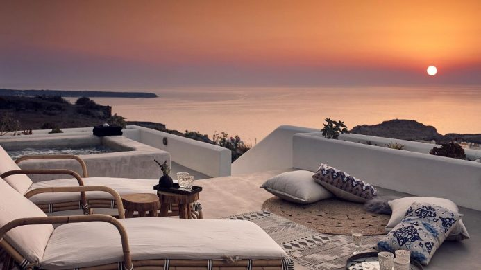 Santo Maris Oia Junior Suite terrace overlooking Aeagan Sea and fiery sunset