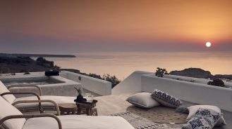 Santo Maris Oia Junior Suite terrace with view of sunset and Aegan Sea