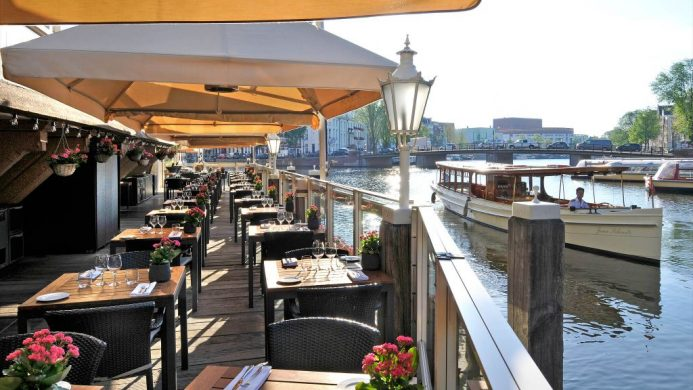 De L'Europe terrace dining over Amstel River