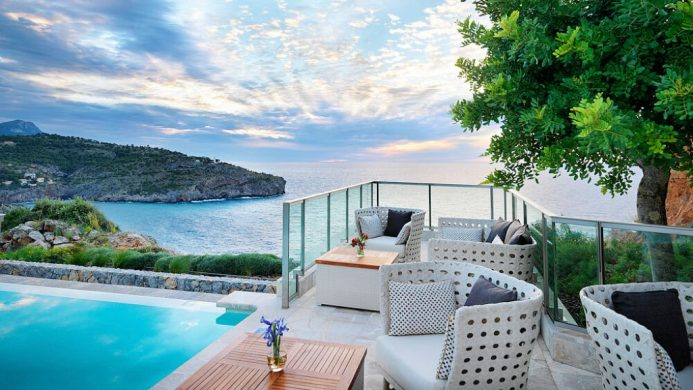 Jumeirah Port Soller Hotel & Spa infinity pool on cliff overlooking mountains and water