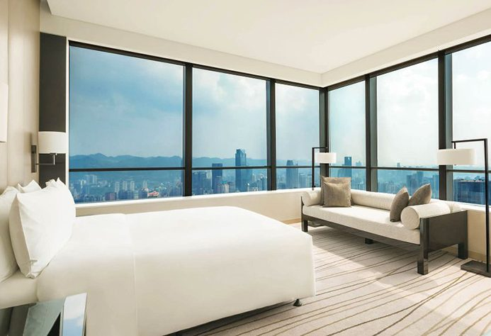 Niccolo Chongqing Grande Deluxe Room with corner floor-to-ceiling windows overlooking the city and tops of buildings