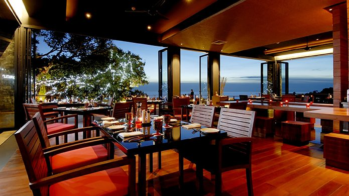 Paresa Resort Phuket's Diavolo restaurant with candle light and open-aired view of ocean