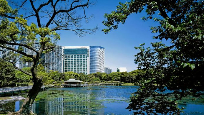 Conrad Tokyo exterior view with gardens and lake
