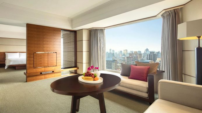 Regent Taipei Junior Suite with floor-to-ceiling window overlooking city