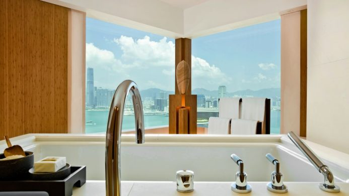 The Upper House Hong Kong bathtub view of water and city
