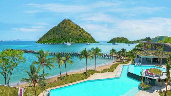 AYANA Komodo Resort pool overlooking ocean and green mountains