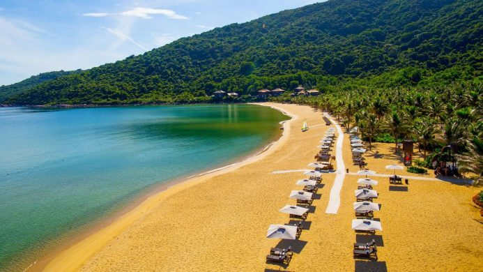 InterContinental Danang Sun Peninsula Resort's golden sand beach nestled on green hill