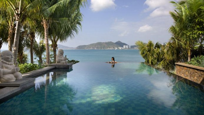 Mandarin Oriental, Sanya woman in infinity pool looking outwards