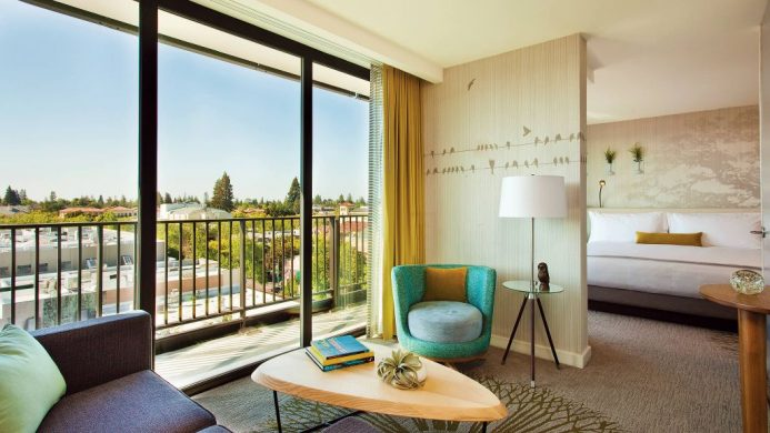 Junior suite with living room, bedroom and balcony at Nobu Hotel Epiphany Palo Alto
