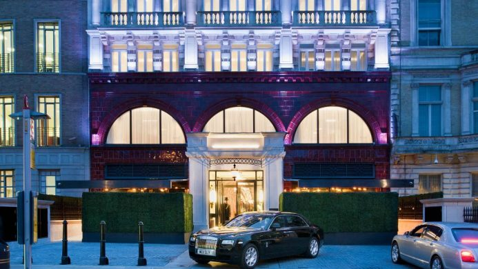 The Wellesley facade entrance with Rolls Royce and door man