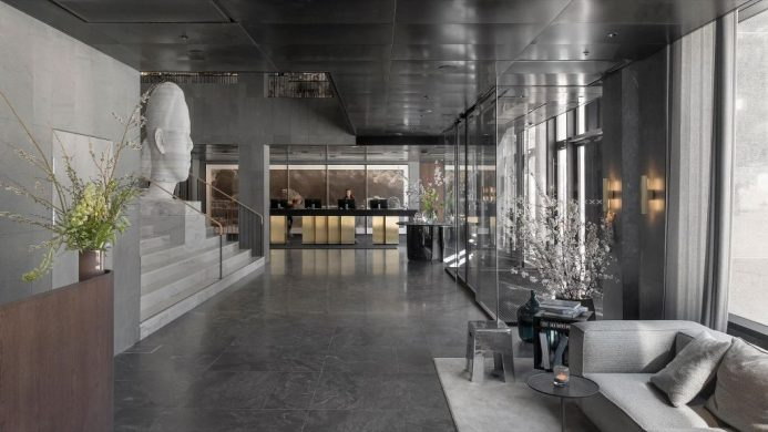 Spacious lobby with cement, marble and sculpture art