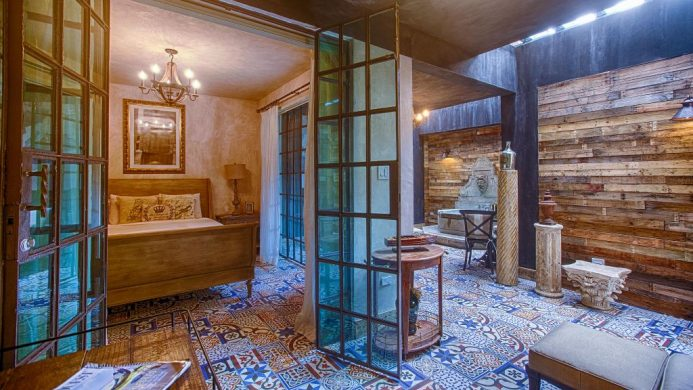Suite with wooden walls, mosaic tiles, skylight and fountain