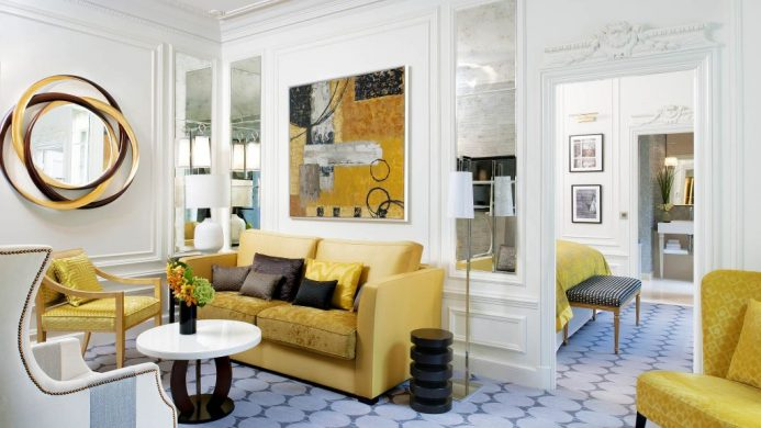 Suite living room with crown moulding and modern yellow sofa