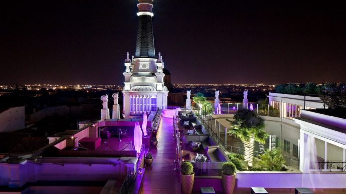ME Madrid Reina Victoria: roof terrace at night with purple lighting