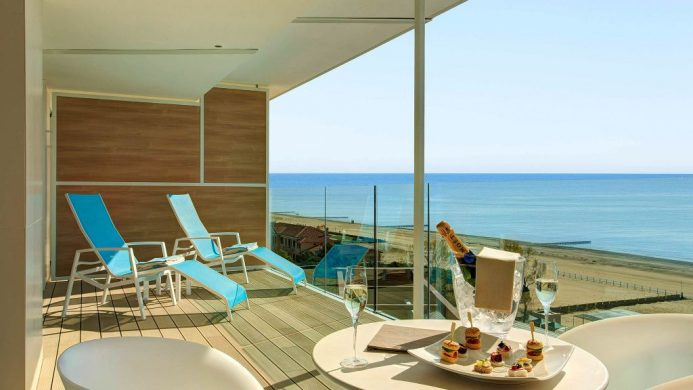 Almar Jesolo Resort & Spa's Prestige Suite terrace with sparkling wine and ocean view