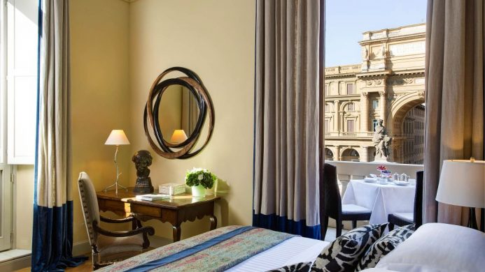 Hotel Savoy's Repubblica Suite bedroom with window view of the piazza