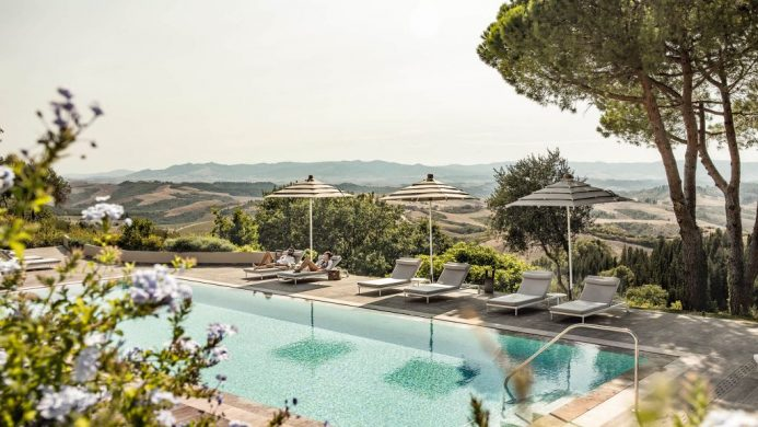 Il Castelfalfi's outdoor pool overlooking rolling hills